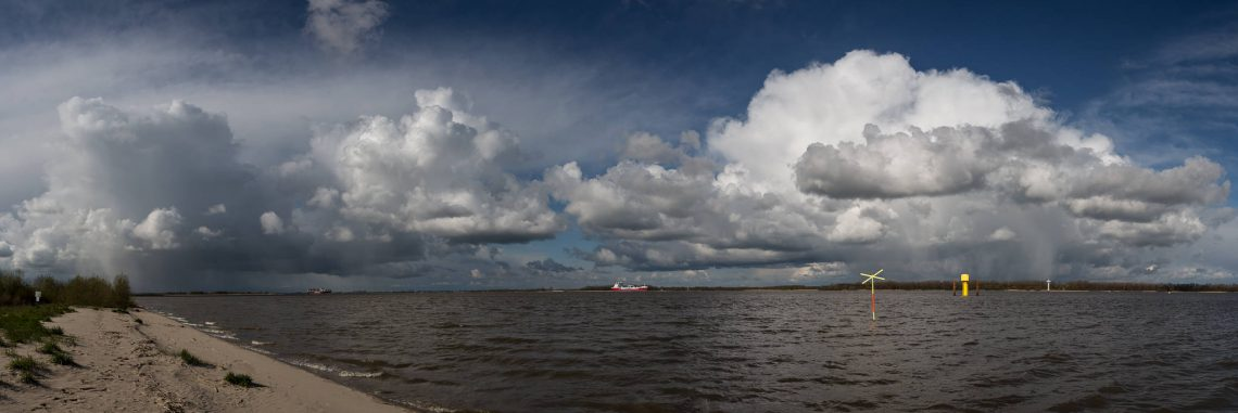 Rain clouds panorama at the river Elbe